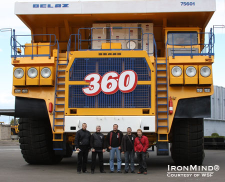 WSF Strongman Federation founder Vlad Redkin (second from the left) gives us an idea of what it means to say they build big trucks at BelAZ.  IronMind® | Courtesy of WSF World Cup.