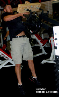 Bert Sorin, who will debut in Pleasanton as a top contender in the Amateur A class, demonstrates the caber training attachment for the Hurricane, a unique machine developed by Sorinex. Richard Sorin describes the Hurricane as being a link between free weights and machines, and Bert Sorin swears by its effectiveness for boosting his Highland Games performance. IronMind® | Randall J. Strossen, Ph.D. photo.