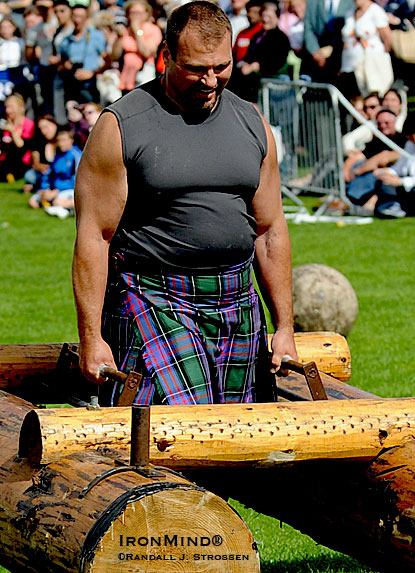 Bill Crawford, M.D. took a brief break from stone lifting as he was part of the team demonstrating strongman events at the 2009 IHGF World Heavy Events Championships.  IronMind® | Randall J. Strossen photo.
