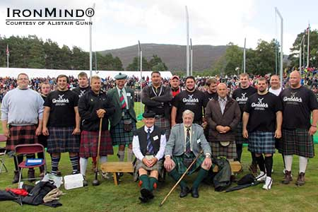 2013 Royal Braemar Highland Games group photo: heavy events winner Scott Rider is third from the left, front row.  IronMind® | Photo courtesy of Alistair Gunn