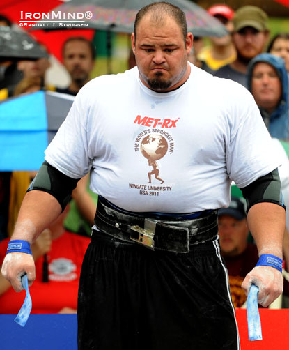 "Not distracted by the rain or intimidated by the 442-kg deadlift at his feet, Brian Shaw psyches up at the 2011 World's Strongest Man contest.  Colin Bryce calls Shaw, ""the hottest property in the strength world,"" and you can see him in person at Giants Live in Melbourne, Australia on March 17–18.  IronMind® 
