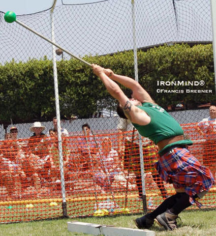 Getting long in the hammer, Larry Brock gets ready to launch another big throw.  IronMind® | File photo by Francis Brebner.