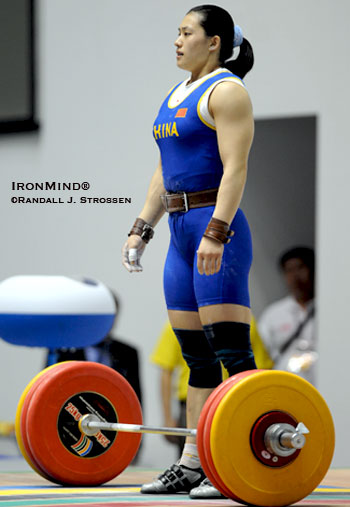 Calm before the storm: Cao Lei (China) is about to clean and jerk 155 kg. IronMind® | Randall J. Strossen photo.