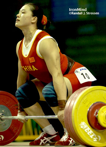 Cao Lei (China) set to rip this 158-kg clean and jerk. Cao Lei won the women's 75-kg category at the World Weightlifting Championships tonight. IronMind® | Randall J. Strossen, Ph.D. photo.