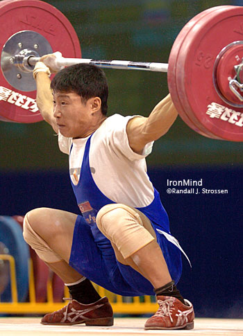 Cha Kum Choi (North Korea) might have had this 130-kg snatch turned down two to one, but he won the gold medal in the total in the 56-kg category at the World Weightlifting Championships today. IronMind® | Randall J. Strossen, Ph.D. photo.