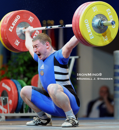 Nikalai Charniak (Belarus) hit this 155-kg snatch on his second attempt at the European Weightlifting Championships, where he won the silver medals in the snatch as well as the clean and jerk, and the gold medal in the total. IronMind® | Randall J. Strossen photo.