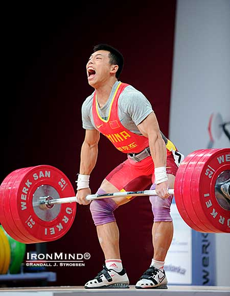 Chen Lijun (China) takes 175 kg for a ride—back to the wall, he made this clean and jerk, good for the silver medal in the jerk and the gold medal in the total at the 2013 World Weightlifting Championships.  IronMind® | Randall J. Strossen photo