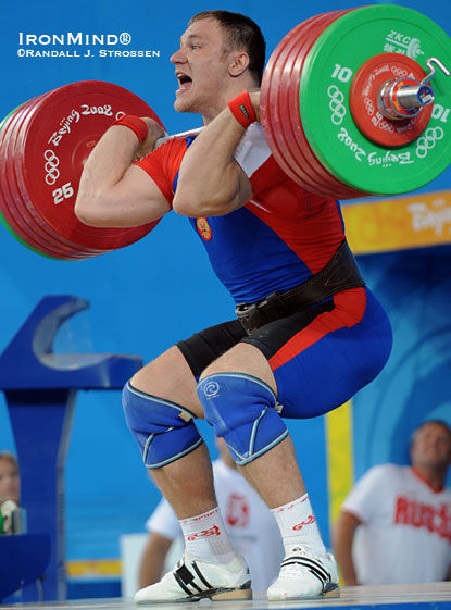 After making five good attempts at the 2008 Olympics, including a huge 210-kg snatch, Russia's Evgeny Chigishev polished off this 250-kg clean and jerk, looking as if he had room to spare.  IronMind® | Randall J. Strossen photo.