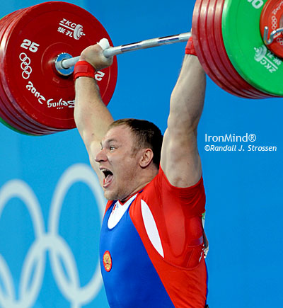 Much to his delight, Evengy Chigishev completed this 250-kg clean and jerk at the 2008 Olympics, putting an exclamation point on a perfect performance by the personable Russian weightlifter. IronMind® | Randall J. Strossen, Ph.D. photo.