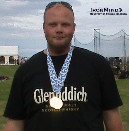 Craig Sinclair sports his two British Hammer Championships medals.  IronMind® | Photo courtesy of Francis Brebner.
