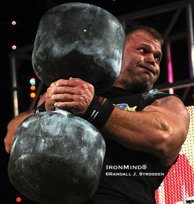 Derek Poundstone decimated the field on the Circus Dumbbell, leapfrogging over Mikhail Koklyaev to claim the 2009 Arnold Strongman title. IronMind® | Randall J. Strossen photo.
