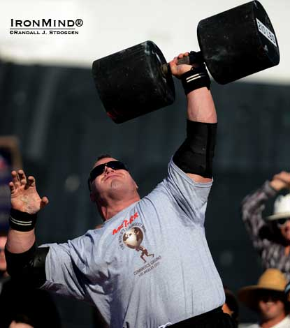 Derek Poundstone hit 11 reps on the Giant Dumbbell press, for a new world record at the 2012 Met-Rx World's Strongest Man contest today.  IronMind® | Randall J. Strossen photo.
