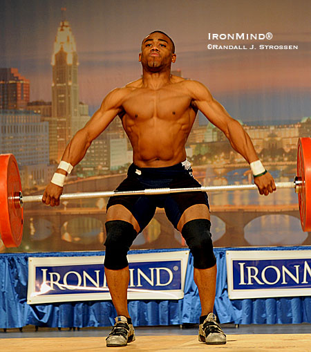 A lean, mean weightlifting machine: The IronMind® Invitational at the 2008 Arnold Sports Festival featured top Chinese weightlifters Zhang Jie and Lu Changliang along with four top American lifters, including Derrick Johnson - and it was Derrick Johnson who first lit up the crowd when he came out to lift with the top of his singlet pulled down. IronMind® | Randall J. Strossen photo.