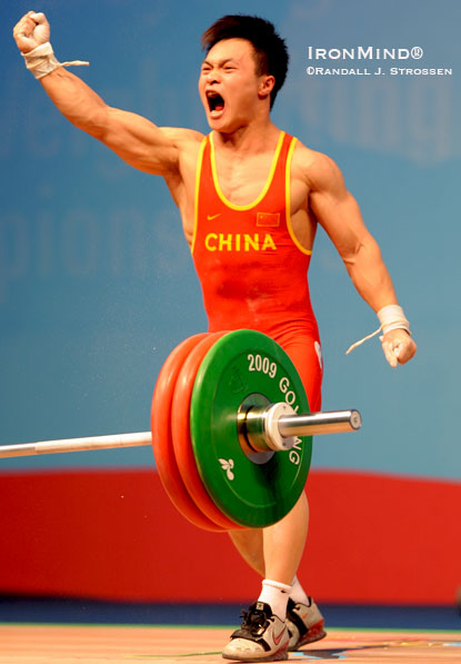 Ding Jianjun (China) celebrates his gold medal 146-kg snatch in the men's 62-kg class at the World Weightlifting Championships.  IronMind® | Randall J. Strossen photo.