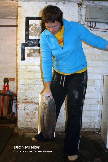 Elizabeth Horne pinch grips a pair of 20-kg plates.  IronMind® | Photo courtesy of David Horne.