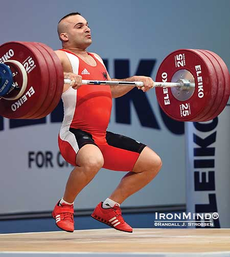 Erkand Qerimaj (Albania) flies under 194 kg in the clean and jerk, adding a gold medal in the total to the one he'd already harvested in the clean and jerk in the 77-kg class at the European Weightlifting Championships in Tel Aviv.   IronMind® | Randall J. Strossen photo