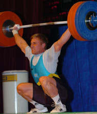 Sergey Filiminov (Kazakhstan) sinks the putt on this world record snatch (173 kg) in the 77-kg category at the 2004 Asian Weightlifting Championships (Almaty, Kazakhstan). IronMind® | Randall J. Strossen, Ph.D. photo.