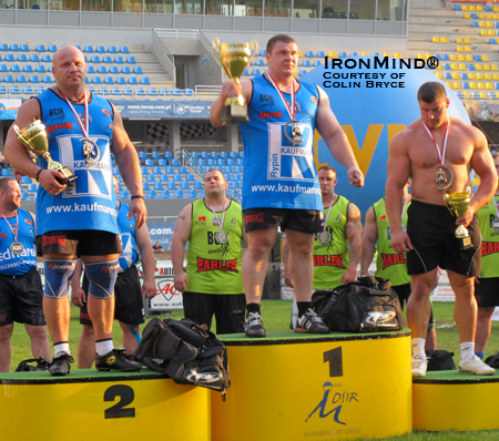 The podium at Giants Live–Poland (left to right): Robert Szczepanksi (third), Vitautas Lalas (winner) and Janusz Kulaga (third).  IronMind® | Photo courtesy of Colin Bryce.