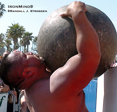 It would be a lot easier if he were at least half a foot taller, but he's not making any excuses . . . Grant Higa gives a lesson in grit, loading stones at shoulder height during the 2004 Battle of Muscle Beach (Venice, California). IronMind® | Randall J. Strossen photo.