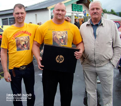 Height runs in his family: Haffþór (center), who stands 205 cm tall, is flanked by his 203-mm tall father (left) and his 207-cm grandfather (right).  Incidentally that HP laptop Haffþór is holding was his prize for winning the OK Budar Strongman Championships in Iceland last weekend.  IronMind® | Photo courtesy of Hjalti Arnason.