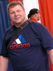 Former WSM competitor and top powerlifter Hjalti Arnason relaxes at the 2004 Arnold Expo, where he was on hand for the strongman competition. IronMind® | Randall J. Strossen, Ph.D. photo.