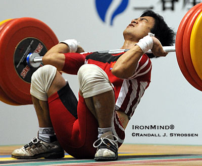 Hoang Anh Tuan (Vietnam) drew a collective gasp from the crowd when he went over backwards with 155 kg on his third attempt clean and jerk, landing flat on his back with the bar over his throat. There was plenty of clearance, so Hoang Anh Tuan was fine - and he won the 56-kg title at the Asian Weightlifting Championships. IronMind® | Randall J. Strossen photo.