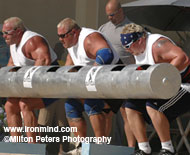 (Left to right) Jon Andersen (USA), Van Hatfield (USA) and Geoff Dolan (Canada) combine forces in the three-man log. IronMind® | Photo courtesy of Milton Peters Photography.