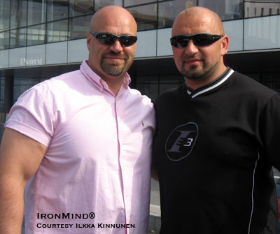 Ilkka Kinnunen (left) and Jasmin Hajdarevic (right) take a moment to relax at the Denmark's Strongest Man contest - Jasmin Hajdarevic won the contest, which Ilkka Kinnunen refereed, along with Marcel Mostert. IronMind® | Photo courtesy of Ilkka Kinnunen.