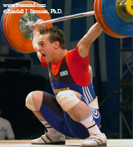 Ilya Ilin (Kazakhstan) sinks the putt on this 168-kg snatch, as part of his riveting performance in the 85-kg category at the 2005 Junior World Championships (Busan, Korea). IronMind® | Randall J. Strossen, Ph.D. photo.