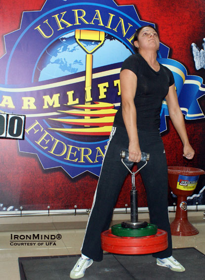 Iryna Postnikova attacking 66 kg on the Rolling Thunder at the second Open Armlifting Championships of Crimea.  IronMind® | Courtesy of UFA.