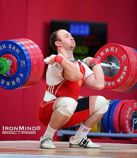 Alexandr Ivanov had missed the jerk on his second attempt (220 kg), but he moved up to 222 kg on his third attempt—in a bid to move into gold medal position at the 2013 World Weightlifting Championships—and he made a good lift.  IronMind® | Randall J. Strossen photo