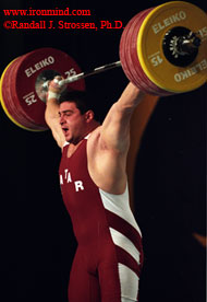 Saeed Salem Jaber (Qatar) snatches 210 kg at the 2003 World Weightlifting Championships (Vancouver, British Columbia). The world's top super heavyweights are capable of snatching over 210 kg, and cleaning and jerking over 260 kg - weights that once lifted are then dropped from arm's length overhead, which makes world-class weightlifting a supreme testing ground for the world's best barbells. IronMind® | Randall J. Strossen, Ph.D. photo.