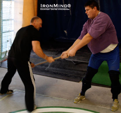 2000 World's Strongest Man winner Janne Virtanen get coached on the hammer by Francis Brebner.  IronMind® | Photo courtesy of United Strongmen.