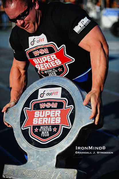 Jason Bergmann, besides finishing an impressive third overall, delivered the MILO moment of the contest: As he approached the finish line on the Shield Carry, Bergmann lost his footing, hitting the deck along with the Shield.  Determined to finish the event, Bergmann grabbed the Shield - like a bull by the horns - and wrestled it over the line.  For a second, it looked like the fully-revved Bergmann was going to just throw the Shield over the line.  IronMind® | Randall J. Strossen photo.