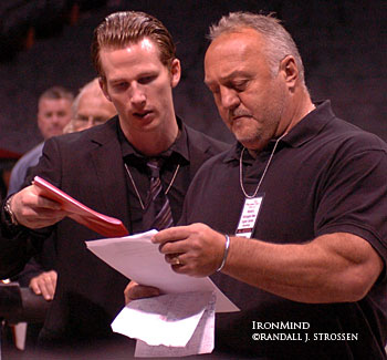 WSMSS Managing Director Jesper Albansson (left) does some pre-contest prep work with the archetypal strongman, Bill Kazmaier. IronMind® | Randall J. Strossen, Ph.D. photo.