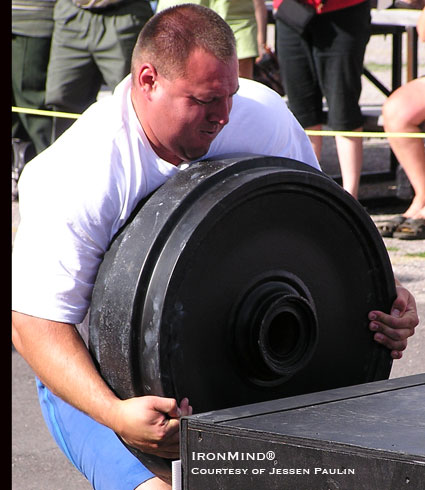 Jessen Paulin, shown loading a 420-pound wheel, is retiring from major international strongman competition. IronMind® | Photo courtesy of Jessen Paulin and FORTISSIMUS.