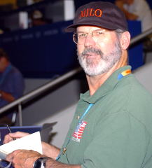 Jim Schmitz in his position as the MILO reporter covering weightlifting at the 2004 Olympics (Athens, Greece). IronMind® | Randall J. Strossen, Ph.D. photo.