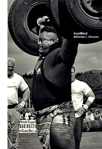 "Joe Onasai on the overhead lift at the 1995 World Strength Championships (Callander, Scotland). Talking about colorful competitors, in addition to Joe, that's Nathan Jones on the left and Phil ""Stonehenge"" Martin on the right. IronMind® 