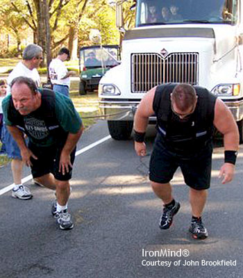 John Brookfield (left) and Jon Bruney (right) on their record truck pull last weekend. IronMind® | Photo courtesy of John Brookfield.