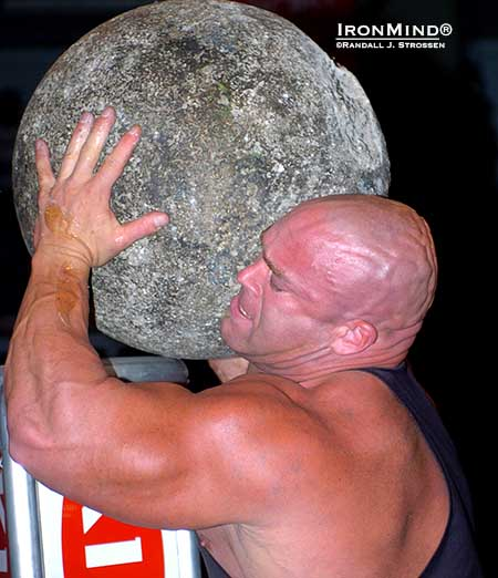 The Jon Andersen might be best known as a professional wrestler, but he was a formidable strongman competitor, too, and his trademark skull was the envy of shar peis worldwide, especially as it struck fear in the heart of big stones.  Here, Jon unloads on  the Atlas Stones at the 2004 World Muscle Power Championships, where he competed in a world class field that included  Zydrunas Savickas, Magnus Samuelsson, Mariusz Pudzianowski, Vasyl Virastyuk, Raimonds Bergmanis, Jessen Paulin, Mark Philippi, Rene Minkwitz, Dominic Filiou, Geoffrey Dolan and Hugo Girard.  IronMind® | Randall J. Strossen photo.
