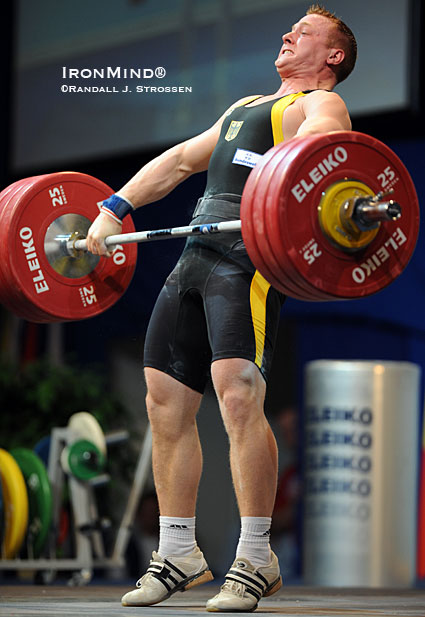 Juergen Spiess (Germany) - shown ripping this 178-kg snatch in the 94-kg category at the 2009 European Weightlifting Championships - is a product of training that includes plenty of doubles, not just limit singles, and this is one of the reasons why his one-rep max is so high.  IronMind® | Randall J. Strossen photo.