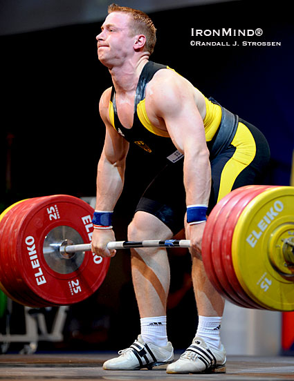 Studying Juergen Spiess (Germany), midway through a clean at the 2009 European Weightlifting Championships (where he won the 94-kg class), illustrates how the clean deadlift and shrug can benefit Olympic-style weightlifters, among others.  IronMind® | Randall J. Strossen photo.