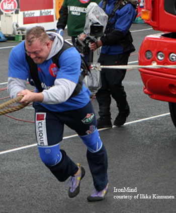 Juha Rasanen on a truck pull - looks like it was raining, but Finnish strongman contests are not for the faint of heart. IronMind® | Photo courtesy of Ilkka Kinnunen.