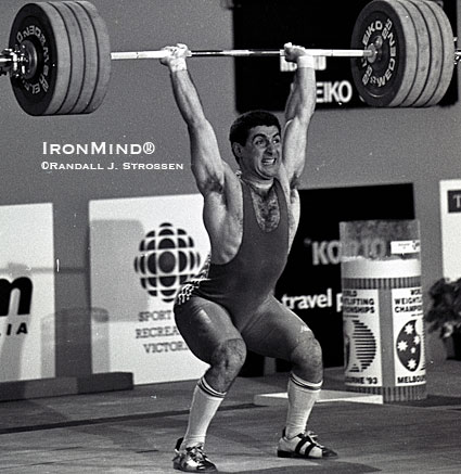 Pounding out a 222.5 clean and jerk at the 1993 World Weightlifting Championships, Kakhi Kakhiashvili displays his trademark power jerk.  IronMind® | Randall J. Strossen photo.