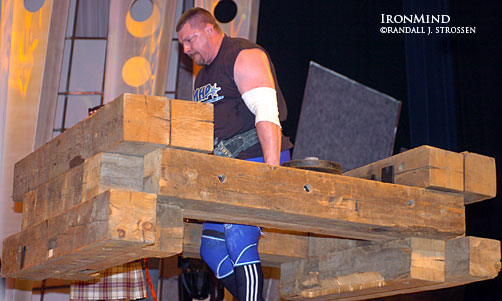 Karl Gillingham on the Timber Walk at the 2005 Arnold strongman contest. This event has become popular at a lot of strongman contests, but don't plan to see it at the Louis Cyr World Strength Challenge next year. IronMind® | Randall J. Strossen, Ph.D. photo.
