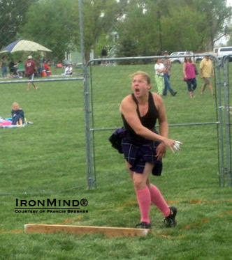Kate Burton, hot off breaking the world record in the 14-lb. weight for distance, will be competing at the IHGF Women's Highland Games Team Championships.  IronMind® | Courtesy of Francis Brebner.