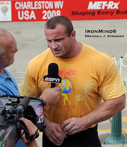 Strongman hits the big time at the World's Strongest Man contest with major media coverage for the strongman contest that created the concept.  Here, Bill Kazmaier (left) interviews Mariusz Pudzianowski (right) for ESPN at the 2008 MET-Rx World's Strongest Man contest.  IronMind® | Randall J. Strossen photo.
