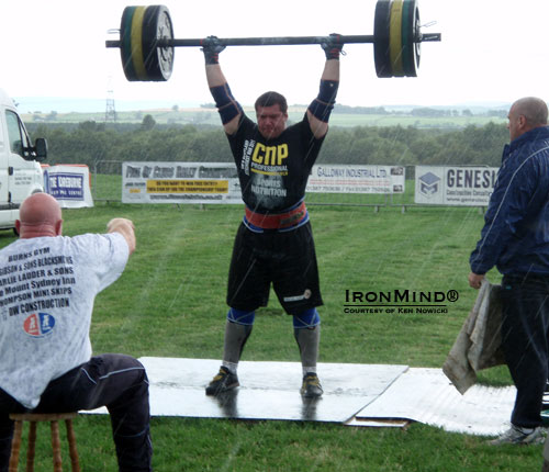 Never mind the rain: Ken Nowicki hits 145 kg in the overhead Axle, on his way to breaking the Scottish record with 160 kg.  IronMind® | Courtesy of Ken Nowicki.