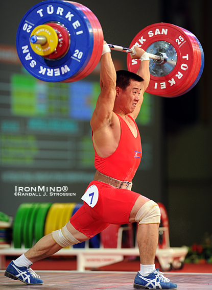 Kim Un Guk (North Korea) stuck this 173-kg jerk to win two gold medals and one silver medal in the 62-kg category at the 2010 World Weightlifting Championships tonight.  IronMind® | Randall J. Strossen photo.