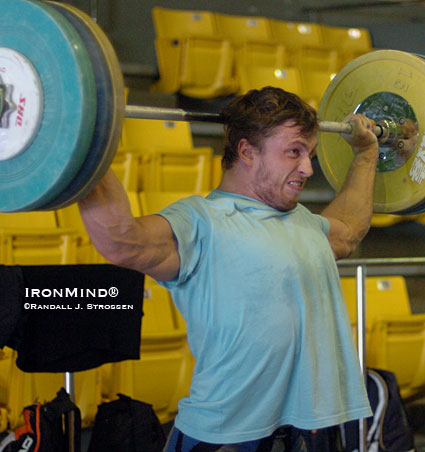 Dmitry Klokov combined squat snatches and presses behind the neck in the training hall at the 2007 World Weightlifting Championships (Chiang Mai, Thailand).  IronMind® | Randall J. Strossen photo.